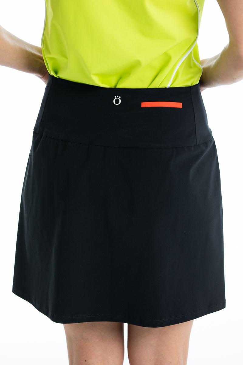 back of women's black golf skort