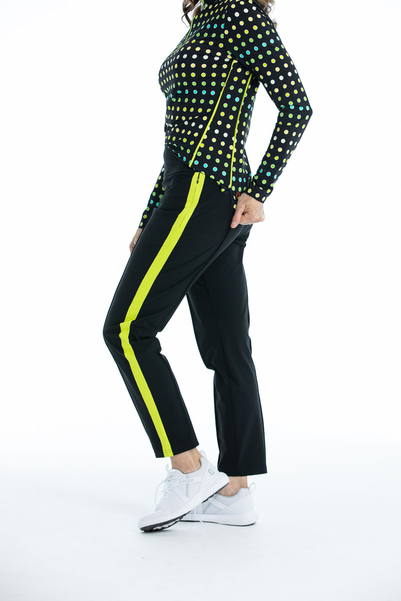 women wearing black golf pants with chartreuse yellow trim