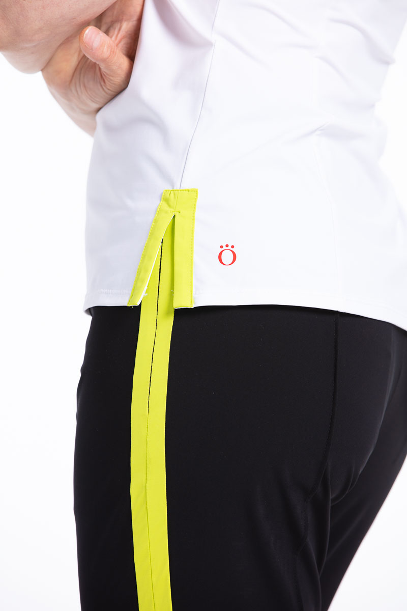 side view of women wearing black pants with a chartreuse yellow trim