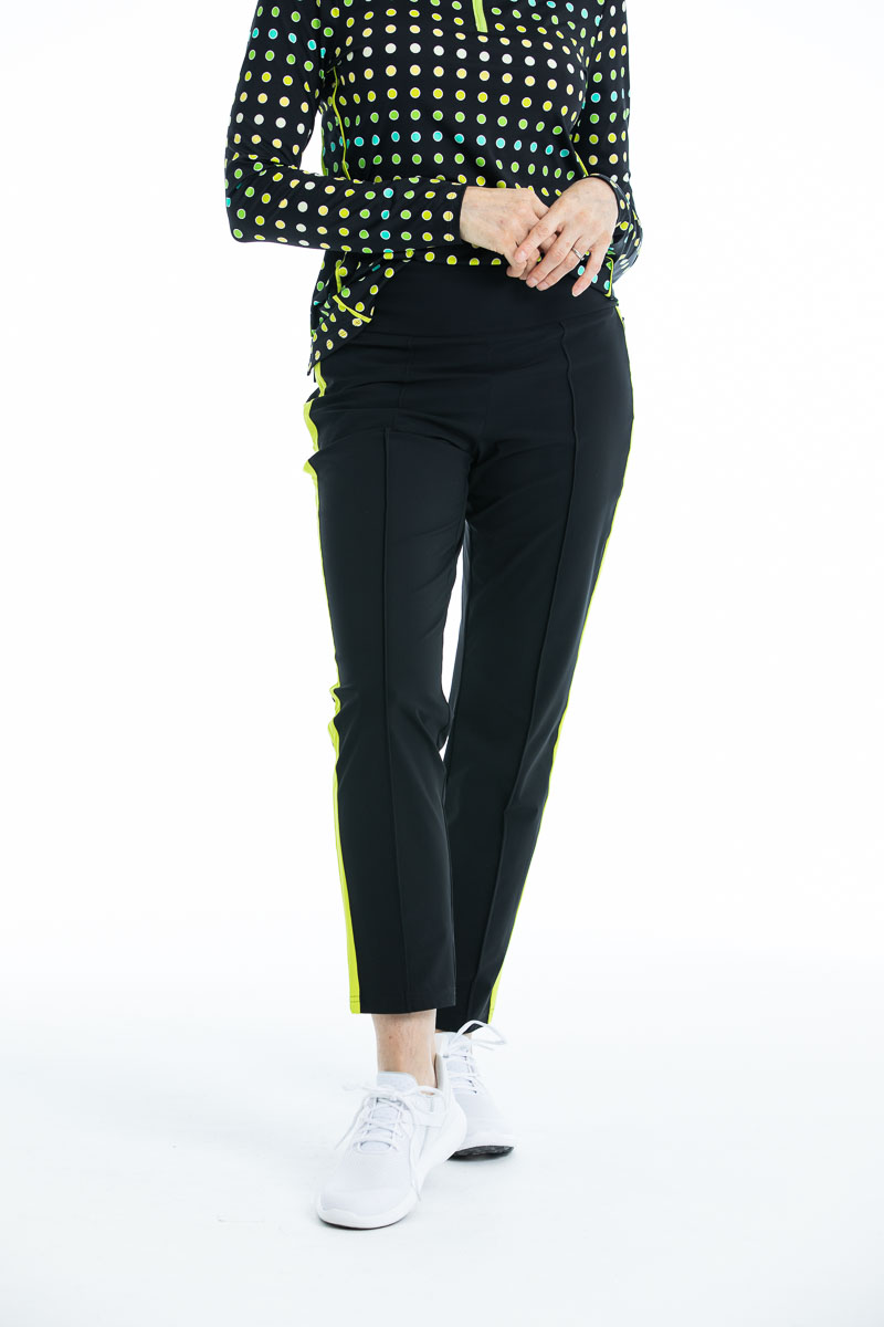 women standing in black golf pants and a polka dot longsleeve golf top