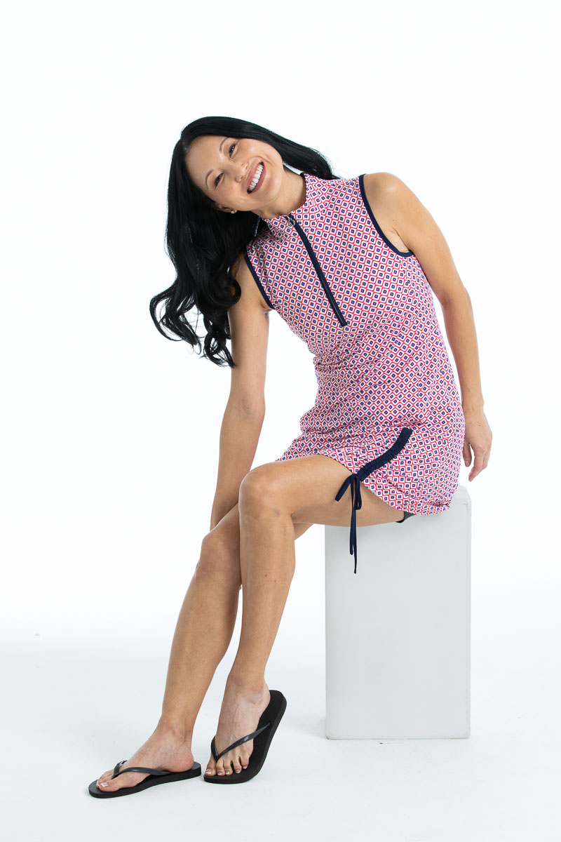 Smiling woman in Rouched and Ready sleeveless golf dress - foulard print