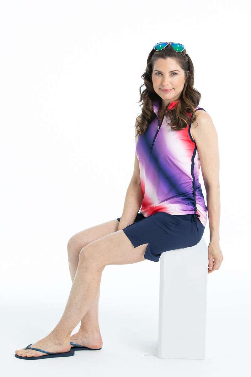 Woman wearing Rouched and Ready sleeveless golf top in ombre print - red, white, and blue