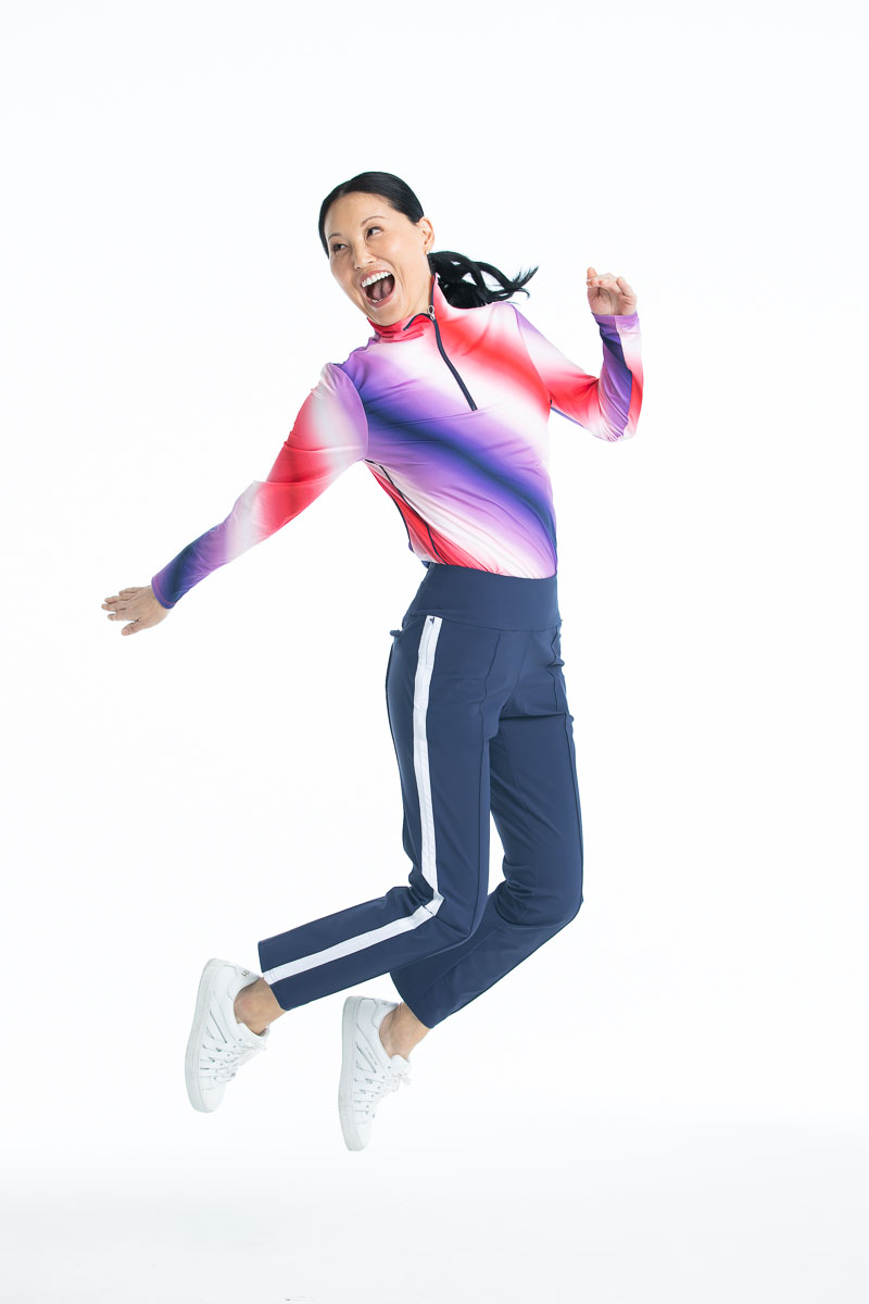 Woman jumping in the Keep it Covered Longsleeve Golf Top in Ombre print