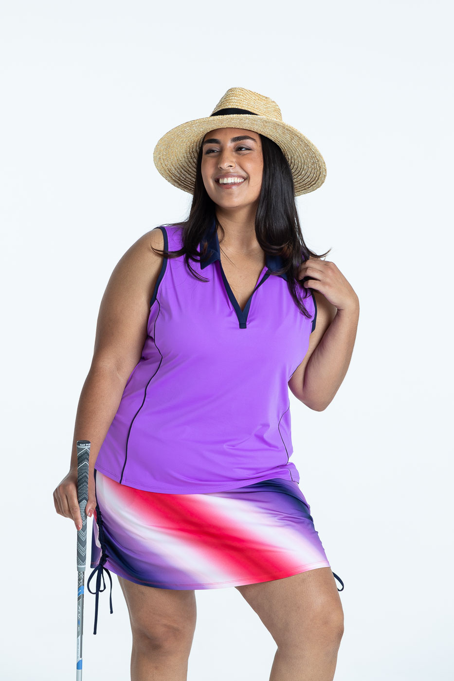 Woman wearing sleeveless lilac Waistlline Winner golf top and Rouched and Ready ombre print skort