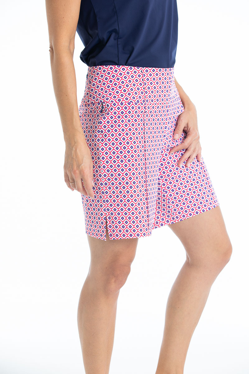 Side view of Tailored and Trim golf shorts - Foulard print and a navy blue Prettier Than A Polo shortsleeve golf shirt