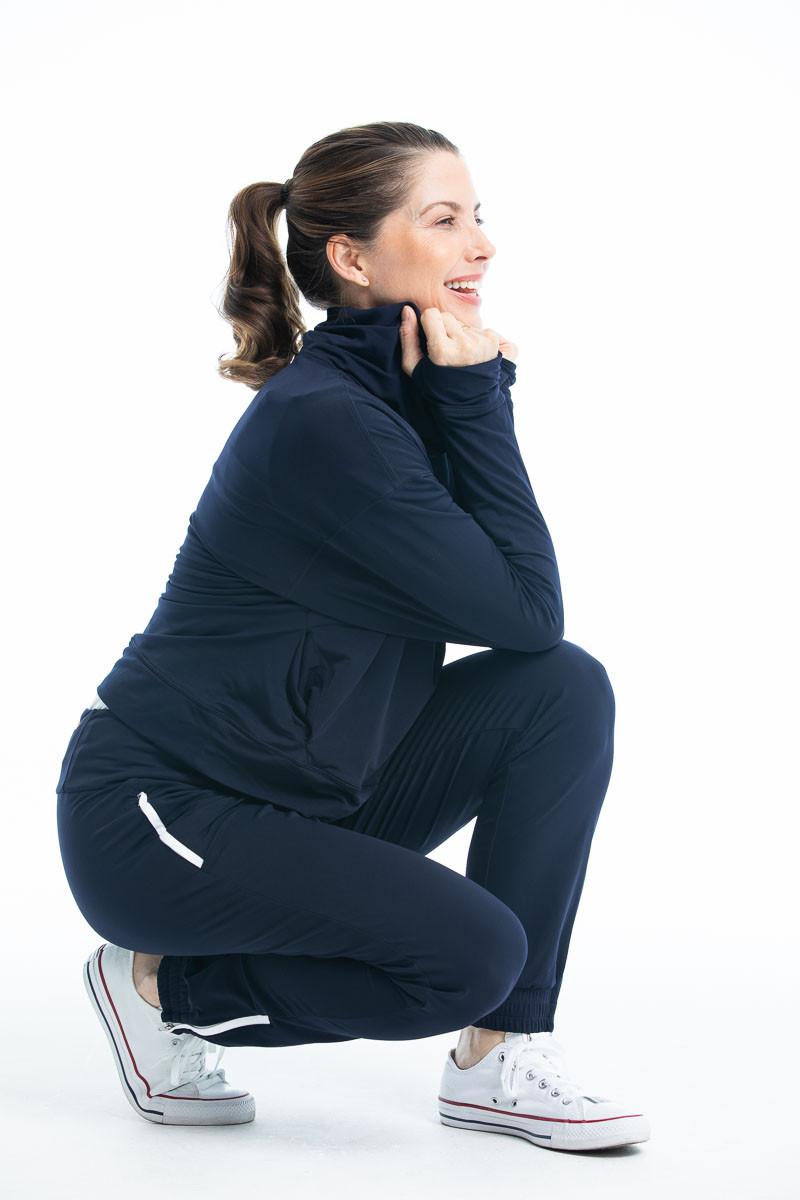 women golfer in jogger pants