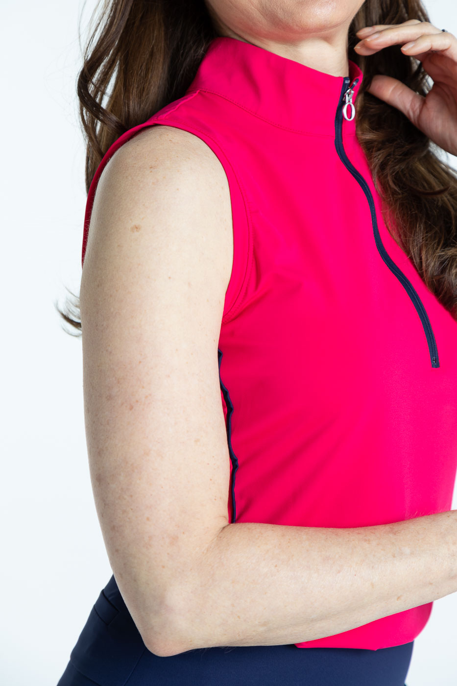 Side view of raspberry red Keep it Covered sleeveless golf top