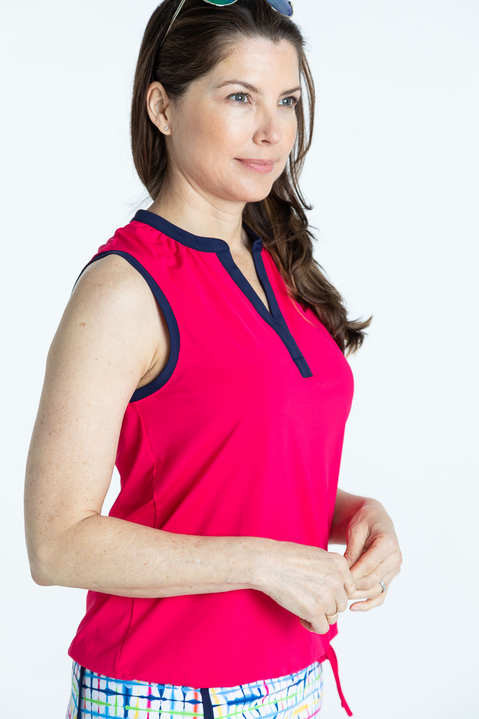 Closer view of woman golfer in raspberry red Free and Easy Sleeveless Golf Shirt