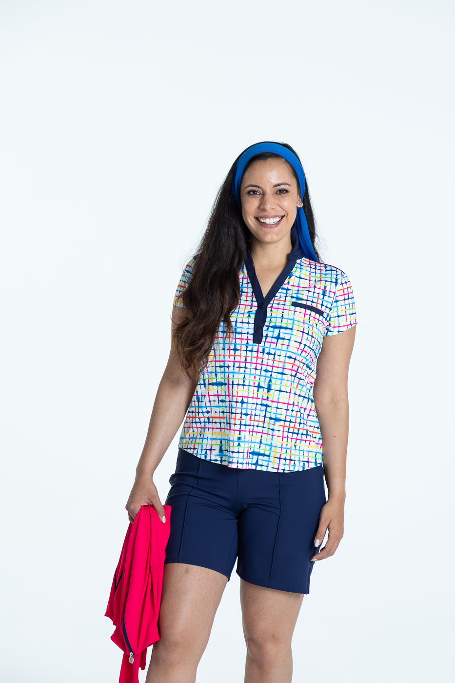 Woman golfer in a blurred lines Shoulder Opener Shortsleeve golf shirt and navy blue Tailored and Trim Golf Shorts
