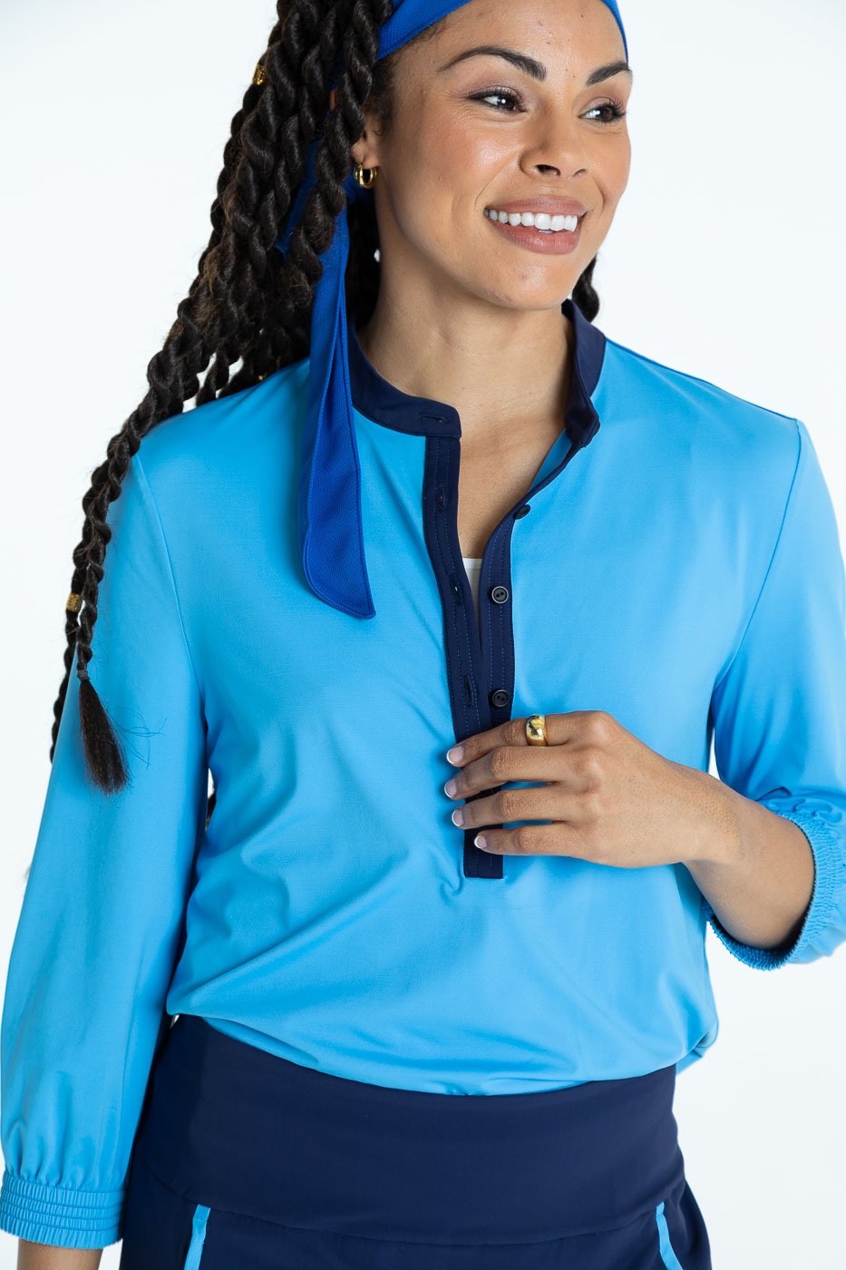 Smiling woman golfer wearing a cornflower blue Swing Easy 3/4 Sleeve golf shirt