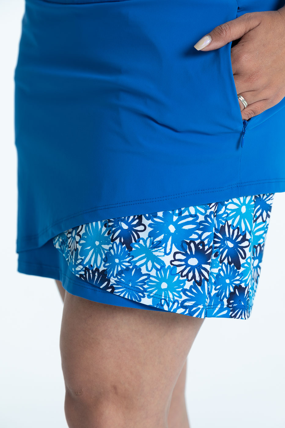 Close side view of the blueberry blue Wrap it Up golf skort