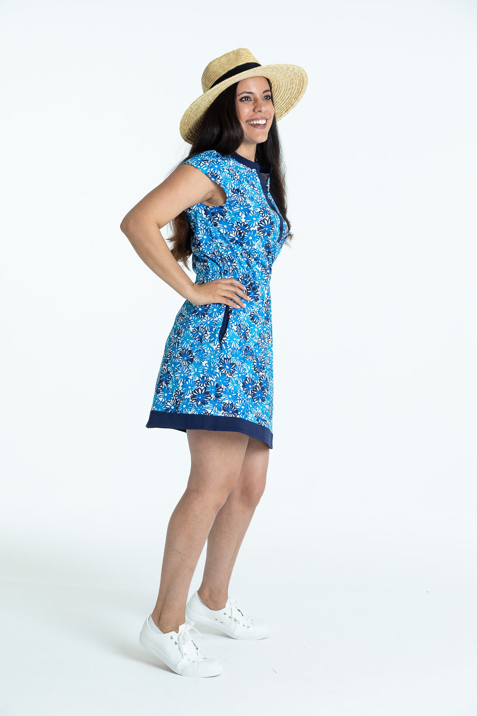 Smiling woman in a crazy daisy Ready to Relax golf dress