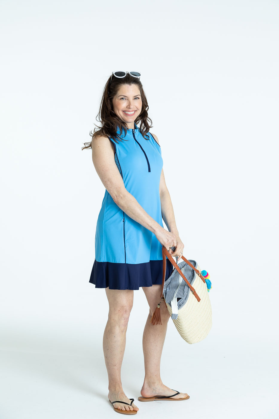 Woman golfer in a cornflower blue Fit and Flare sleeveless golf dress