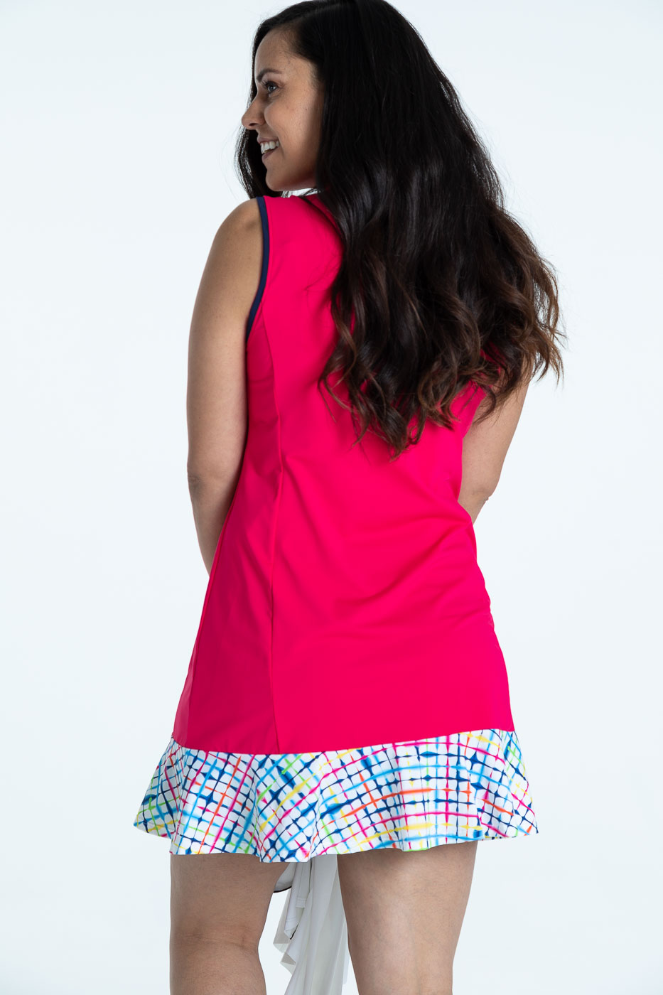 Back view of woman in a raspberry red Fit and Flare sleeveless golf dress