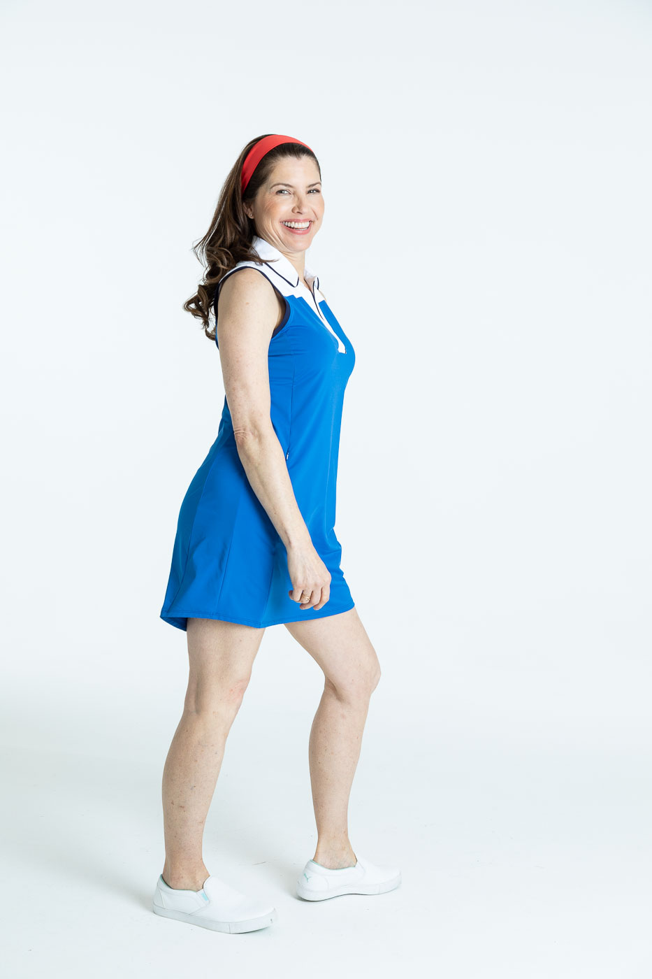Side view of woman in blueberry blue Chip Shot golf dress