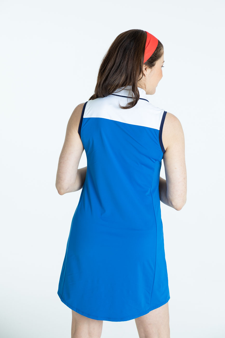 Back view of woman in blueberry blue Chip Shot golf dress