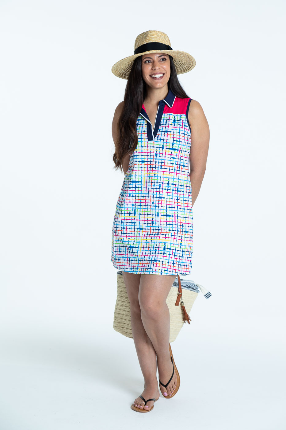 Woman wearing a blurred lines Chip Shot sleeveless golf dress
