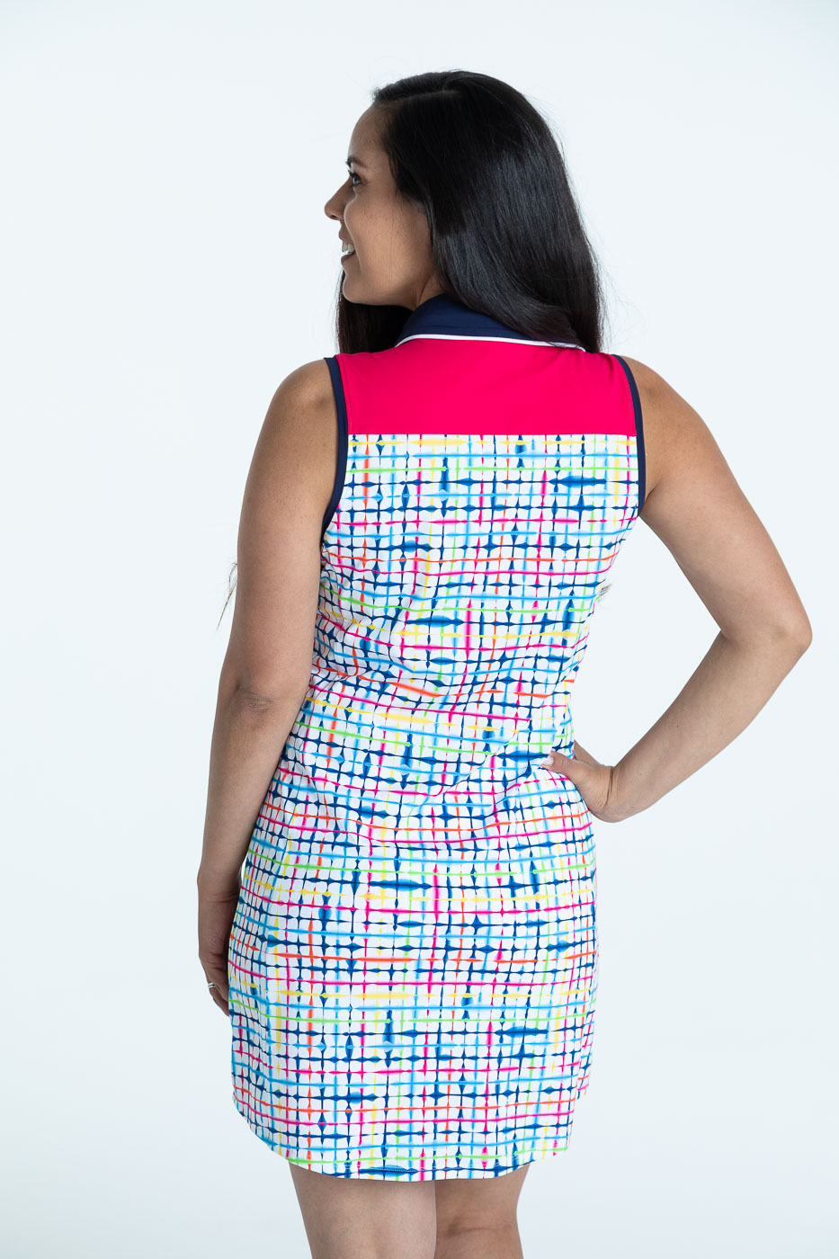 Back view of woman wearing a blurred lines Chip Shot sleeveless golf dress