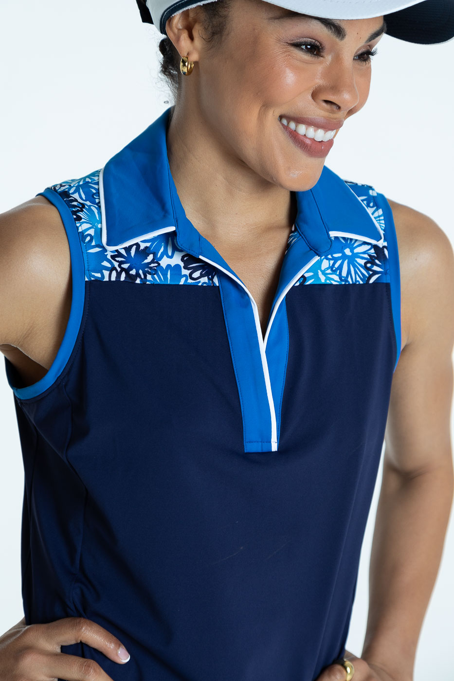 Close-up front view of woman wearing a navy blue Chip Shot sleeveless golf dress