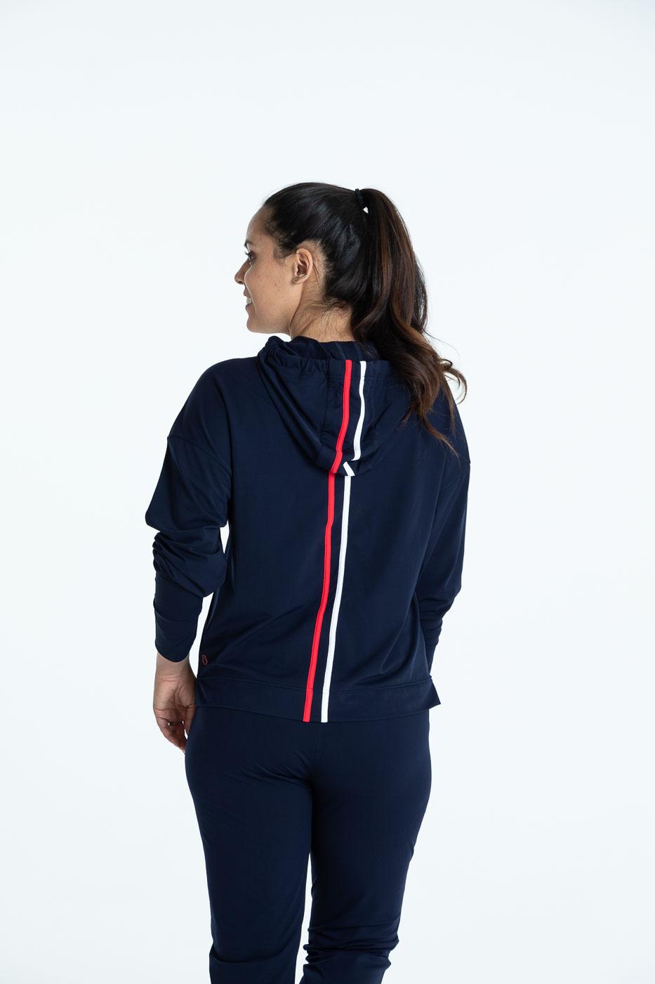 Back view of woman wearing a navy blue Apres 18 Sporty Stripe Longsleeve Hoodie