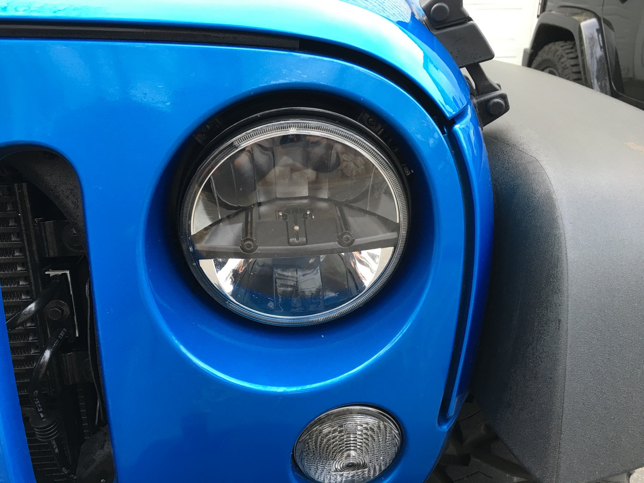 Show on Jeep Wrangler with Truck-Lite Headlamp