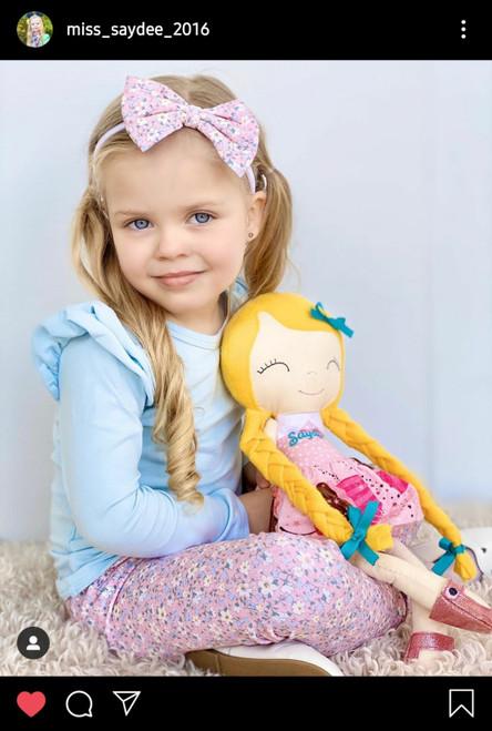 Blonde doll pictured with model Saydee ( instagram.com/miss_saydee_2016/ )