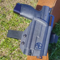 CZ P10C with TLR1 shown with the full UBL, QLS and thigh strap system.