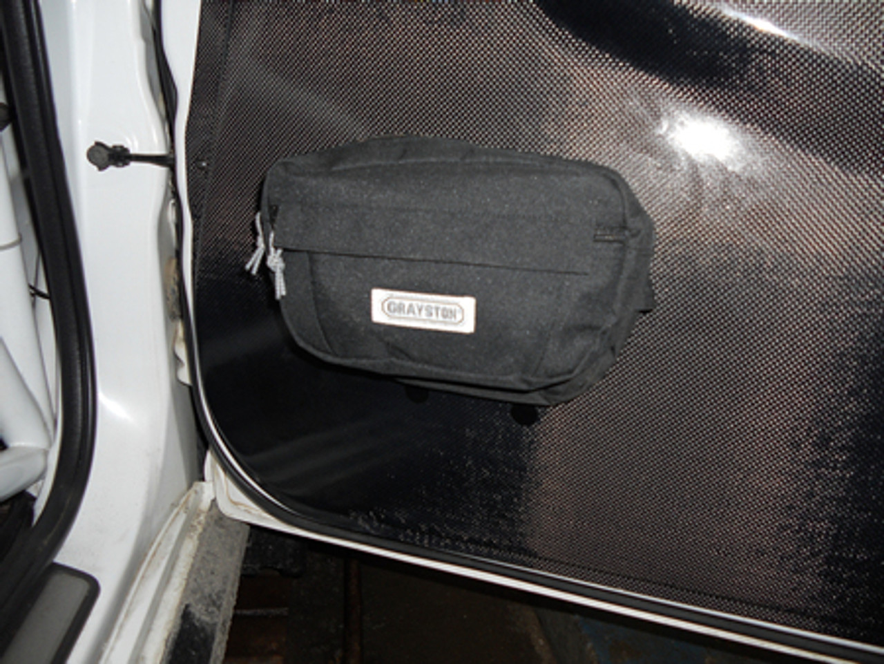 Door or roll cage mounted storage bag
