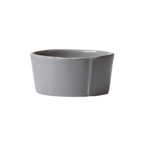 The Vietri  Lastra Gray Condiment Bowl is rustic, chic, and the perfect size for small appetizers. An overlapping wooden mold, used for centuries to form cheeses throughout Italy, inspired this collection.
