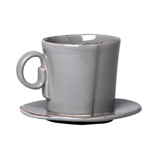 """The Lastra Gray Espresso Cup and Saucer are rustic, chic, and utterly charming. An overlapping wooden mold, used for centuries to form cheeses throughout Italy, inspired this collection. 3""""H LAS-2609G"""
