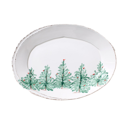 """Delight in the magic of the holiday season with the Lastra Holiday Small Oval Platter. Whether you are hosting a winter brunch or a Christmas dinner, this collection is the perfect complement to your holiday décor. Handpainted on Italian stoneware in Tuscany. 13.5""""L, 10""""W LAH-2625"""