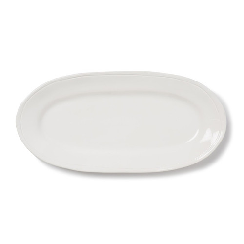 """Functional and versatile, the Fresh White Narrow Oval Platter is a guaranteed favorite for everyday dining. Enjoy anything but ordinary style when you serve a homemade meal or even takeout on this simple and clean dish. 16.25""""L, 8""""W VFRS-2629W"""