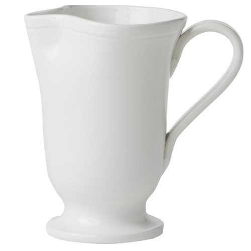 """Casual entertaining gets an update with the Fresh White Large Footed Pitcher. A stylish piece for fresh lemonade or summer sangria, this handmade vessel easily pairs with your favorite family heirlooms while encouraging you to live simply and celebrate often. In style, of course. 8.25""""H, 5 Cups VFRS-2616W"""