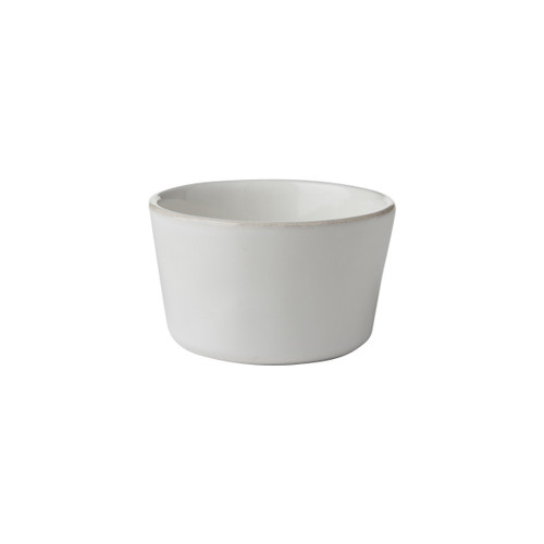 "Puro Whitewash Ramekin  № KS12/10  Like your favorite white shirt, this tasteful dish boasts an understated elegance that allows whatever it contains to shine in the spotlight - from homemade lemon pots de creme after dinner to an unexpected vessel to pop seasonal flowers into.   Measurements: 4"" W x 2.5"" H Capcity: 8 ounces Made of Ceramic Stoneware Oven, Microwave, Dishwasher, and Freezer Safe Made in Portugal"