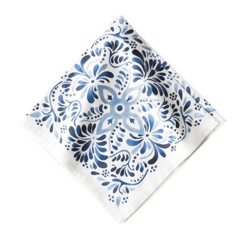 "Iberian Journey Indigo Napkin  № LB54/046  A journey to the sandy Iberian coast inspired this Iberian Journey motif where we've reinterpreted this region's stunning cobalt blue painted tiles onto a crisp white backdrop.     Measurements: 22"" Square Material: 100% Cotton Machine wash cold, gentle cycle. Tumble dry low and warm iron as needed. Imported"