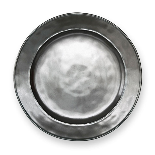 "Pewter Stoneware Dinner Plate  № KP01/91  From our Pewter Collection- A sleek minimalism anchors this plate firmly in the present, but its lustrous pewter hue and finish will inspire thoughts of romantic and rainy Parisian streets or moonlit serenades on Venetian canals.  Measurements: 11"" W Made of Ceramic Stoneware Oven, Microwave, Dishwasher, and Freezer Safe Made in Portugal"