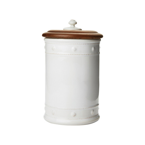"Berry & Thread Whitewash 11.5"" Canister with Wooden Lid  № JA109/W  From our Berry & Thread Collection- Adorned in our rich basket weave motif and capped with an Ash Wood lid that keeps necessary supplies at your fingertips, yet under wraps. Great for your kitchen, bathroom, and office.  Measurements: 6"" W x 11.5"" H Capacity: 3.5 quarts Made of Ceramic Stoneware and Ash Wood Made in Portugal"