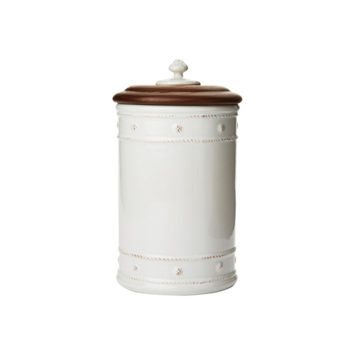 "Berry & Thread Whitewash 10"" Canister with Wooden Lid  № JA108/W  From our Berry & Thread Collection- Adorned in our rich basket weave motif and capped with an Ash Wood lid that keeps necessary supplies at your fingertips, yet under wraps. Great for your kitchen, bathroom, and office.  Measurements: 5.5"" W x 10"" H Capacity: 2.25 quarts Made of Ceramic Stoneware Made in Portugal"
