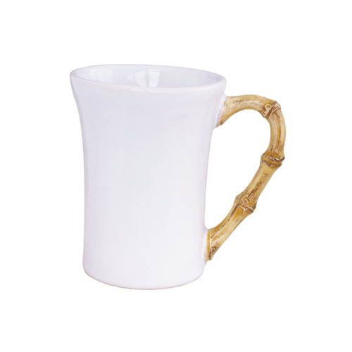 """Classic Bamboo Natural Mug  № KM06/34  From our Classic Bamboo Collection- Drink deeply from this fetching mug before whisking off to the airport to catch a plane for Dubai.  Measurements: 3.5"""" W x 5"""" H Capacity: 12 ounces Made of Ceramic Stoneware Oven, Microwave, Dishwasher, and Freezer Safe Made in Portugal"""