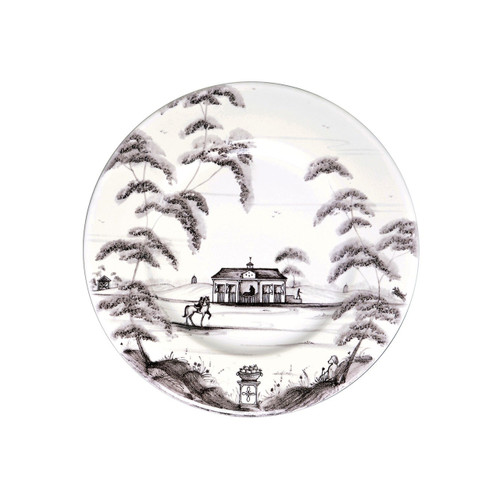 "Country Estate Flint Side Plate Stable  № CE03/94  From our Country Estate Collection- A galavant across the fields on your favorite filly from our stables promotes rosy cheeks and stimulates the appetite. Our side plate is the perfect companion to a slice of homemade bread, generously slathered with butter. Featuring: Stable and Golf Hut.  Measurements: 7"" W Made of Ceramic Stoneware Oven, Microwave, Dishwasher, and Freezer Safe Made in Portugal"