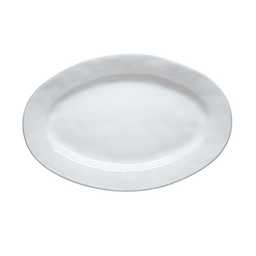 """№ KQ55/17 From our Quotidien Collection - For your main-course masterpiece! Our platter's simple organic form paired with lustrous white glaze creates the perfect backdrop for your piece de resistance.   Measurements: 15"""" L x 10"""" W Made of Ceramic Stoneware Oven, Microwave, Dishwasher, and Freezer Safe Made in Portugal"""
