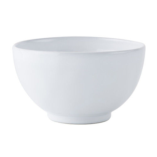 "Quotidien White Truffle Cereal/Ice Cream Bowl  № KQ07/17  From our Quotidien Collection - Whether you enjoy fresh berries and granola at breakfast or homemade sorbet after dinner, our clean white cereal bowl is a timeless companion to every meal. Blends brilliantly with our Firenze and Le Panier collections.   Measurements: 6"" W x 3.5"" H Capacity: 28 ounces Made of Ceramic Stoneware Oven, Microwave, Dishwasher, and Freezer Safe Made in Portugal"