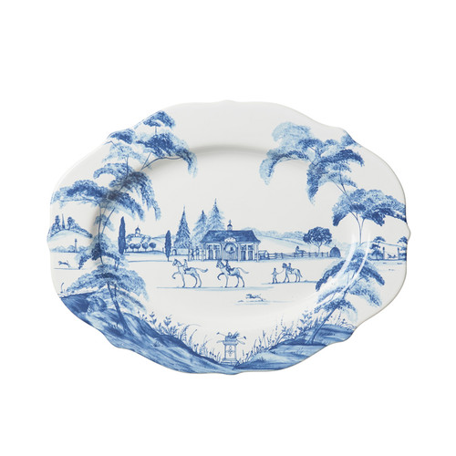 """Country Estate Delft Blue 15"""" Serving Platter Stable  № CE55/44  From our Country Estate Collection- Bring a dash of the graceful equine and noble pursuits to the table with this stately serving platter that serves as handsome housing for everything from Sunday roast to an assortment of cheeses. Our ceramic stoneware is made in Portugal and is oven, microwave, dishwasher and freezer safe.  Measurements: 15"""" L, 11"""" W Made of Ceramic Stoneware Oven, Microwave, Dishwasher, and Freezer Safe Made in Portugal"""