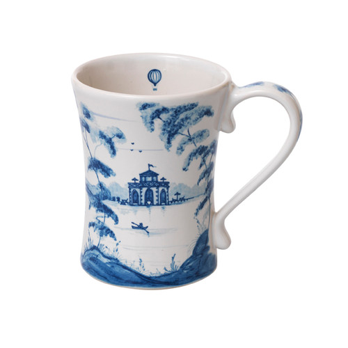 "Country Estate Delft Blue Mug Sporting  № CE06/44  From our Country Estate Collection - Embark upon every daily adventure with a piping hot cup of coffee, whether you go punting on the river or play a round of golf. Featuring: Boathouse, Golf Hut, and Stable. Our ceramic stoneware is made in Portugal and is microwave, dishwasher, oven, and freezer safe.  Measurements: 3.5""W, 4.5"" H  Capacity: 12 ounces Made of Ceramic Stoneware Oven, Microwave, Dishwasher, and Freezer Safe Made in Portugal"