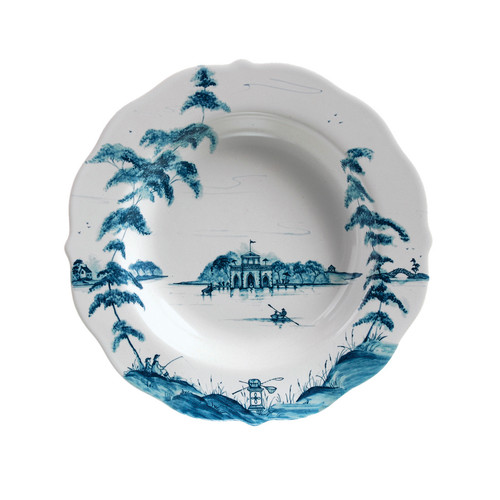 "Country Estate Delft Blue Pasta/Soup Bowl Boathouse  № CE08/44  From our Country Estate Collection- Too much of a good thing is wonderful, like summer splashing, winter skating, and clandestine rendezvous at the boathouse. Ladle your mother's homemade chicken soup or pasta bolognese into these bowls, which are excellent for generous helpings. Featuring: the Boathouse. Our ceramic stoneware is made in Portugal and is oven, microwave, dishwasher and freezer safe.  Measurements: 10""W, 1.5"" H  Capacity: 10 ounces Made of Ceramic Stoneware Oven, Microwave, Dishwasher, and Freezer Safe Made in Portugal"