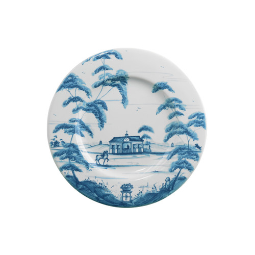 "Country Estate Delft Blue Side Plate Stable  № CE03/44  From our Country Estate Collection- A galavant across the fields on your favorite filly from our stables promotes rosy cheeks and stimulates the appetite. Our side plate is the perfect companion to a slice of homemade bread, generously slathered with butter. Featuring: Stable and Golf Hut.  Measurements: 7"" W Made of Ceramic Stoneware Oven, Microwave, Dishwasher, and Freezer Safe Made in Portugal"