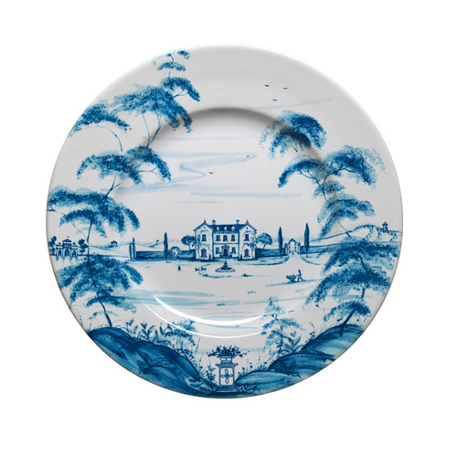 "Country Estate Delft Blue Dinner Plate Main House  № CE01/44  From our Country Estate Collection- Welcome to the main house, where friends and family have gathered for generations and country food is raised to a point of fine art. A feast for the eyes and table, our stately dinner plate is a portrait of the inviting and bustling life you can explore on the estate and where you can always find something delectable bubbling away in the kitchen. Featuring: the Main House, Boathouse, and Apple Orchard.  Pruduct Measures: 11"" W Made of Ceramic stoneware Oven, Microwave, Dishwasher, and Freezer Safe Made in Portugal"
