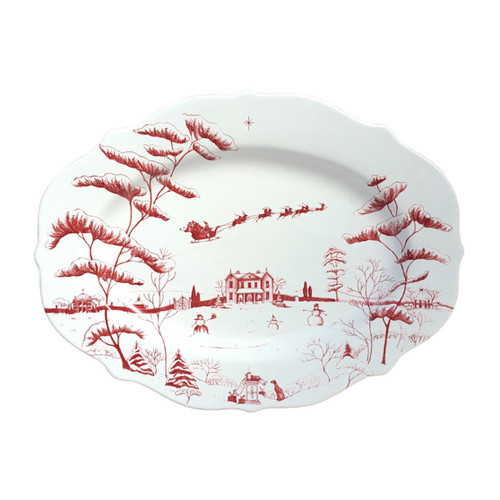 """Country Estate Winter Frolic Ruby Serving Platter Christmas Eve  № CE55/73  From our Country Estate Collection- For the Grand Arrival, this bounteous platter is sure to elicit oohs and ahhs. Illustrated with our Country Estate Main House in winter, it is perfect for presenting your show stopping heritage turkey, honey ham, or Beef Wellington. Our ceramic stoneware is made in Portugal and is dishwasher, freezer, microwave and oven safe.  Measurements: 15"""" L, 11"""" W Made of Ceramic Stoneware Oven, Microwave, Dishwasher, and Freezer Safe Made in Portugal"""