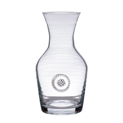 "Berry & Thread Wine Carafe  № B716/C  From our Berry & Thread Collection- With a single berry and thread stamp for a bit of understated adornment- this covetable carafe will serve you well, from a vineyard picnic to upscale supper party.  Measurements: 7"" H Capacity: 20 ounces Made in Portugal Dishwasher safe. Warm gentle cycle. Hand washing is recommended for large or highly decorated pieces Not suitable for hot contents, freezer or microwave use"