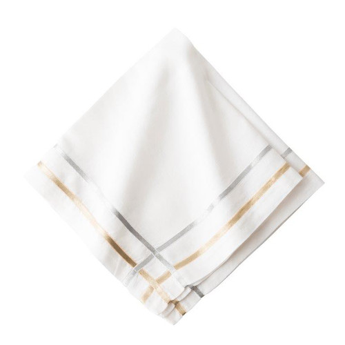 "Metallic Ribbon Lattice Napkin Set/4  № LB45/50  Metallic gold and silver trim shimmers against a pristine white linen backdrop to add a dash of glamor and shine to everything from a lavish New Year's Eve dinner to a romantic fireside tete-a-tete.  Measurements: 22"" Sq Material: 60% Cotton, 40% Linen Machine wash; line dry. Imported"